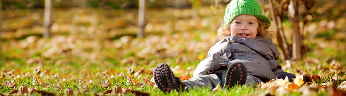 Child wrapped up warm on playing field