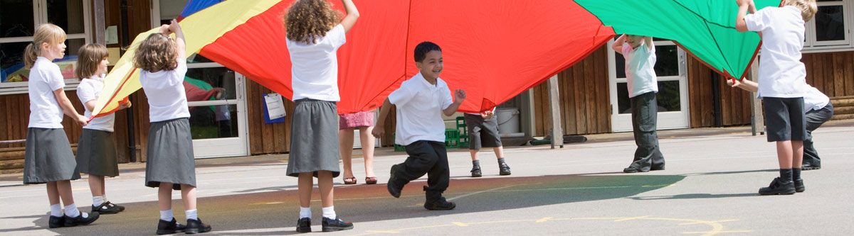 Children in playground with parachute