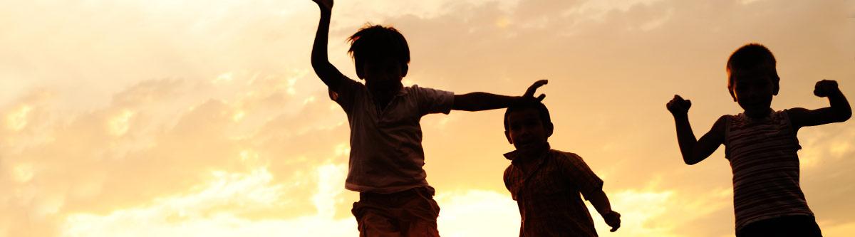Children silhouette against the sunset